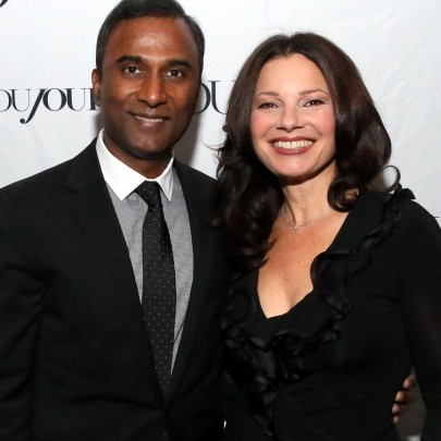 NEW YORK, NY - NOVEMBER 06:  Inventor/entrepreneur Shiva Ayyadurai (L) poses with Fran Drescher as she celebrates her Cancer Schmancer Movement with DuJour's Jason Binn and SEN's Tora Matsuoka on November 6, 2013 in New York City.  (Photo by Astrid Stawiarz/Getty Images for DuJour Magazine)