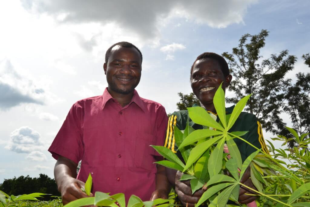A-woman-group-leader-smiles-along-with-their-extension-worker-inside-the-tissue-culture-derived-cassava-field-1024x683