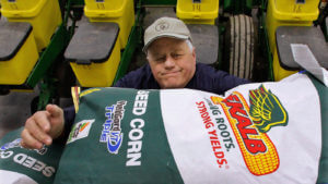 Farmer prepares genetically modified seed corn